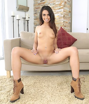 Gentle Latina babe wearing sexy shorts is happy to demonstrate her nice ass and natural tits. Her lover is penetrating her with pleasure.