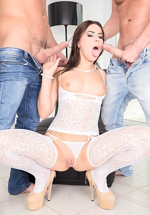 Lovely model wearing sexy white stockings is trying to satisfy two big guys. She is going mad about theis sensational erected cocks.