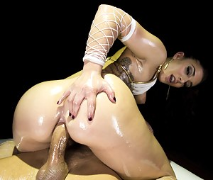 Feeling her lover's boner into her ass hole is what this brunette in white fishnet is fond of. She is being punished hard in the dark studio.