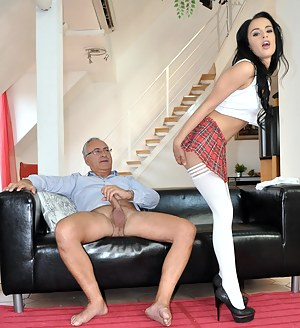 Brunette hoe in high heels and stockings fucking an old cock