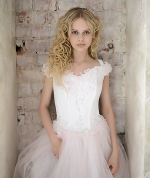Stunning blonde teen celebrates her early marriage with stripping her bride clothes and shows some of her naked body.