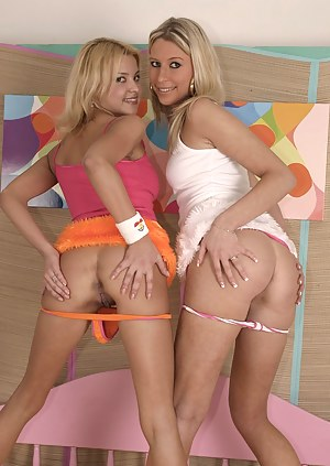 Two blonde teenage honeys spreading their sexy long legs