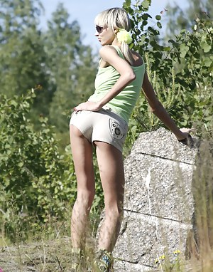 Hot sun beams and beautiful view make blonde beauty teen loose her mind as she starts removing clothes.