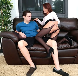 Lovely chick wearing stockings, skirt and high heels is fucking in the office. Her partner is penetrating this babe's sweet holes with passion.