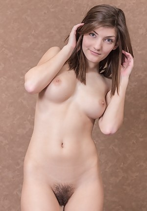 Vita S is young and sexy sitting on her bed. She strips to her lingerie and then gets naked, showing off her all-natural body. She spreads her 20 year-old body, and gives us a view of her young hairy pussy.