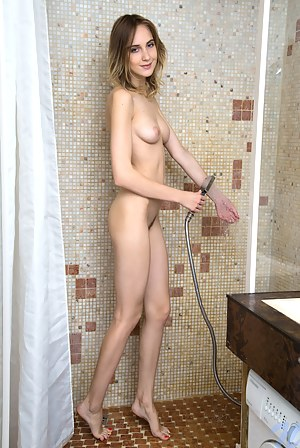 Cock hungry coed makes her tight twat squirt in the shower