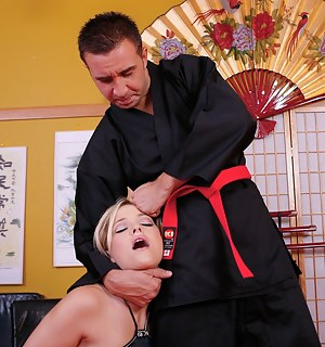 Powerful kung-fu master is presenting this busty blonde with wild fuck session. He is taking off his black uniform and banging her hard.