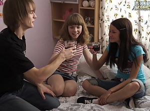 Two wonderful shapely teen bombshells in enticing group FFM hardcore action on the bed.