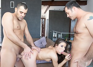 Sensational young chick is playing dirty games with two brutal guys. She is sucking their cocks and enjoying hardcore double penetration with excitement.