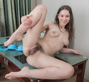Beautiful Canella drinks her milk and gets sexier by the minute. She wears blue lingerie which makes her glow. She slides her hands across her all-natural body and all over her elegant hairy pussy here.