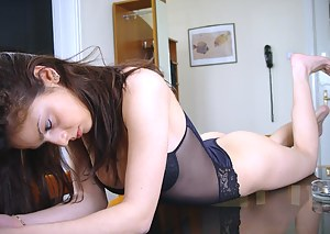 Teen fingers her pussy while spread in a chair