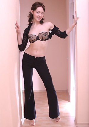 Fresh and sexy slim girl strips off her black clothes including her bra and panties